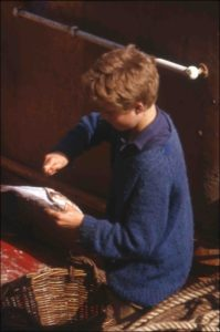Picture of boy gutting fish