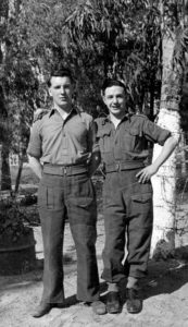 A photograph of Ron Smith (left) on National Service 1946