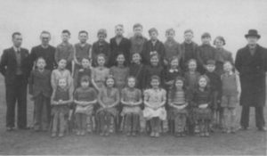 School photograph of St Cuthbert's, North Shields with Canon Keenleyside on the right