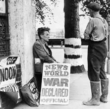 Photograph of a newspaper seller in central London on 3 September 1939