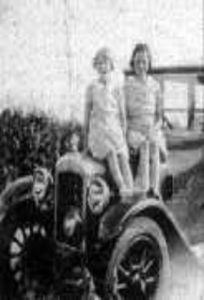 Photograph of sitting on a car, 1937