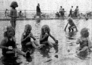 Photograph of children in paddling pool, 1952