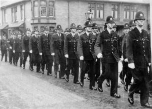 Photo of Tynemouth police marching in 1948 with new look collar and tie uniforms